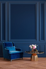 Classic Royal Blue Interior With Armchair, Coffee Table, Flowers And Wall Moldings. 3d Render Illustration Mockup.