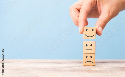 customer satisfaction concept. smiling face on sad face Fototapete