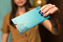 Girl Holds A Gift Certificate In Spa