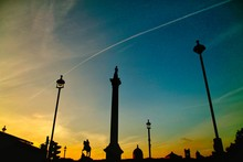 Low Angle View Of Silhouette Nelson Column Against Sky During Sunset
