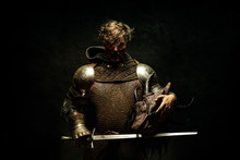 Portrait Of A Knight In Armor, His Sword In His Hand, Holding A Dragon Head In The Other Hand
