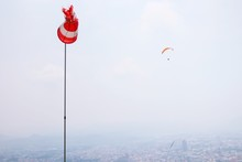 Low Angle View Of Windsock Against Parachute In Sky