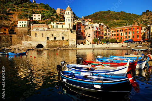 Fotografie, Obraz Boats On Sea Against Buildings At Cinque Terre