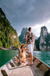 canvas print picture - Khao Sok national park Cheow Lan Dam, Ratchaprapha Dam or Rajjaprabha Dam at Suratthani, Thailand couple on vacation