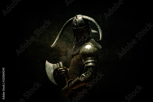 Portrait of a Viking Berserker warrior, holding an ax in his hands Canvas Print
