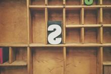 Letter S On Wooden Shelf