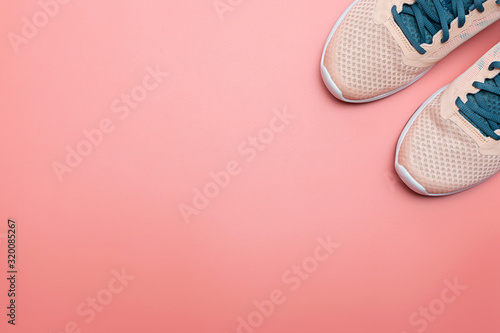 Fototapeta Light pink sneakers on trendy pink background with copy space for your design. Healthy lifestyle and fitness concept. Running shoes on pink background. Minimalism style composition. obraz na płótnie