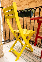 Yellow Chair On The Balcony