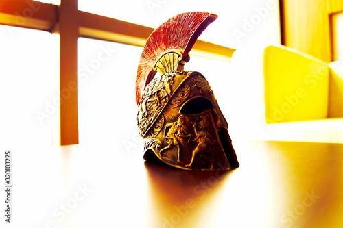 Fotografiet Close-Up Of Cavalry Helmet On Table By Window