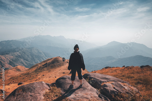 Fototapeta A woman standing on the slopes Beautiful mountain views obraz
