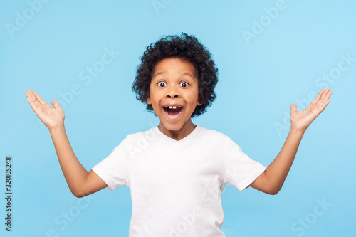 No way, I can't believe! Portrait of funny amazed preschool boy keeping hands up in astonishment, looking surprised and sarcastic at camera, excited shocked by sudden news Canvas Print