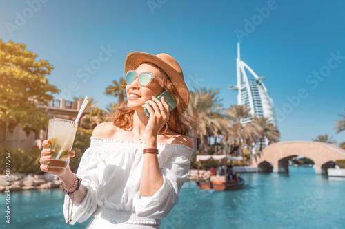 Happy girl drinking mojito cocktail in Dubai resort фототапет