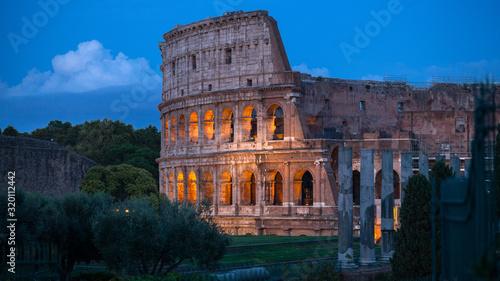Colloseum at sunset in Rome, Italy Wallpaper Mural