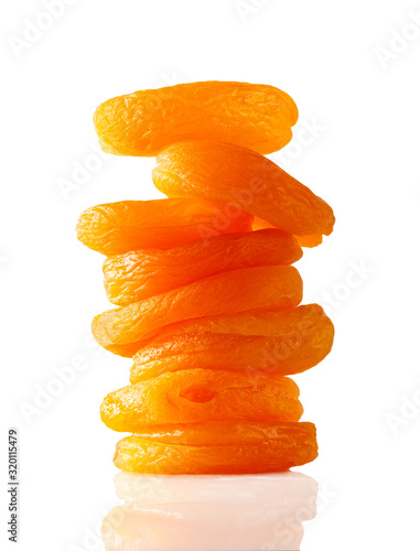 stack of dried apricots isolated on white background Wallpaper Mural