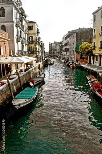 BOATS IN CANAL WITH BUILDINGS IN BACKGROUND © alexis baca/EyeEm