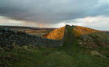 Hadrians Wall On Field Against Cloudy Sky During Sunset