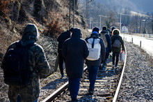 Group Of Migrants Walking Alon...
