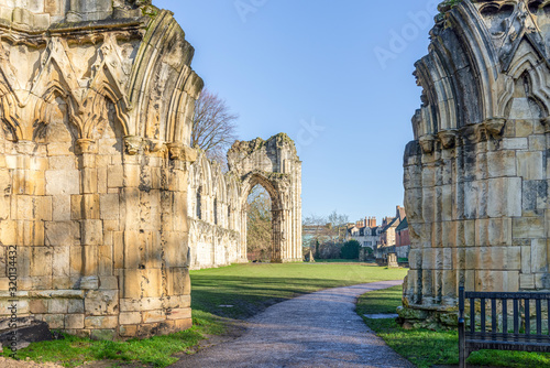Ancient ruins of a medieval abbey. Wallpaper Mural