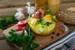 Leinwanddruck Bild Baked potato stuffed with herbs, egg, bacon