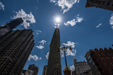 Low Angle View Of Flatiron Building Against Sky On Sunny Day