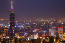 Illuminated Taipei 101 By Cityscape At Night
