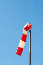 LOW ANGLE VIEW OF Windsock AGAINST CLEAR BLUE SKY