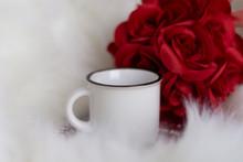 White Mug Red Rose Fur Backgro...