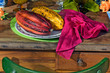 canvas print picture - Cocoa fruits on table decorated with tropical colors