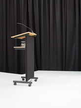 Podium With Microphone Against...