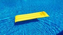 High Angle View Of Yellow Pool...