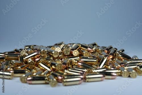 Fotografie, Obraz Close-Up Of Ammunitions On Table