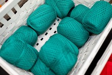 Set Of Turquoise Yarns On A Wh...