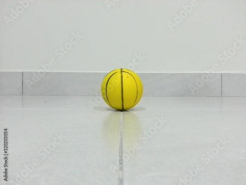 Obraz Close-Up Of Yellow Basketball On Floor - fototapety do salonu