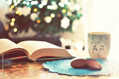 Tela Biscuits With Cup And Open Book On Table