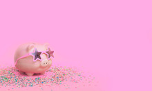 A Pink Piggy Bank In Fun Glasses At A Party. Pink Background.