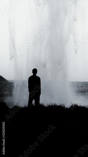 Fotografie, Obraz Silhouette Man Standing Against Geyser