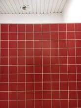 Red Tile Wall Against Ceiling