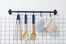 Kitchen Utensils Hanging On Wall