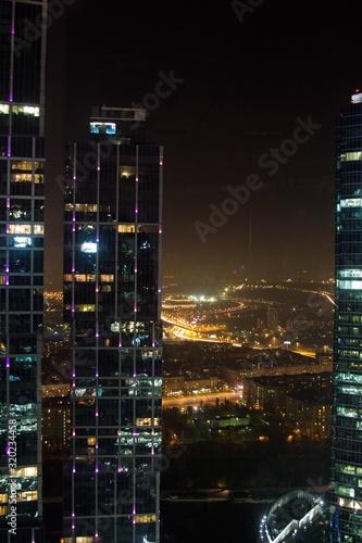 Fototapety, obrazy: CITY LIT UP AT NIGHT