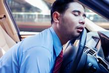 Businessman Sleeping On The Steering Wheel