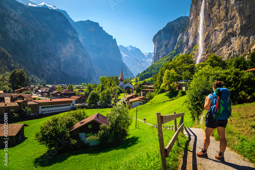 Woman hiker with backpack enjoying the view in Lauterbrunnen, Switzerland Canvas Print