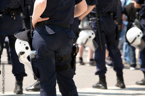 Rear View Midsection Of Female Police Officer Standing With Hand On Hip Tapéta, Fotótapéta