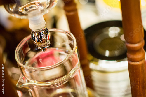 Glass Container At Coffee Maker Faucet Fotobehang