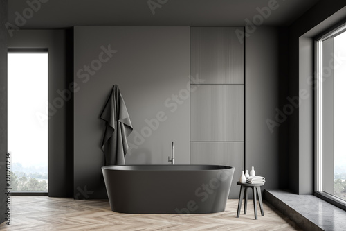 Gray and wooden bathroom interior with tub