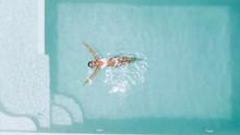 Woman Relaxing In Clear Pool W...