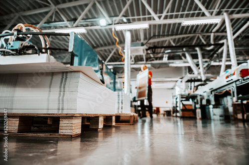 Fotomural Low angle view of piles of sheets in printing shop