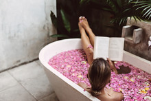 Woman Reading Book While Relax...