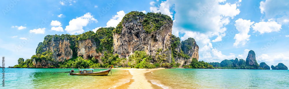 Fototapeta Travel concept. Amazing view of beautiful beach with longtale boat. Artistic picture. Beauty world. Panorama. Creative collage.