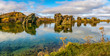 canvas print picture Amazing sunny day on lake Myvatn, Iceland, Europe. Volcanic rock formations reflected in the blue clear water of a volcanic lake. Artistic picture. Beauty world. Travel concept. Panorama