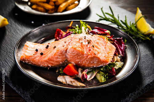obraz PCV Roasted salmon with french fries and vegetable salad